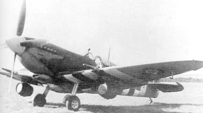 Spitfire with beer kegs on ground
