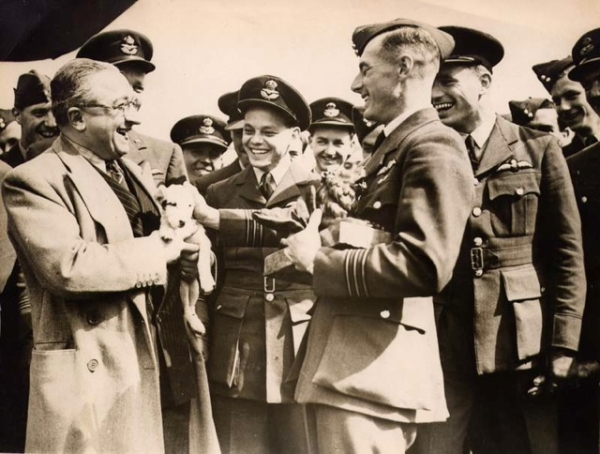 Presentation of the Lion - May 1943 by Mr. Echkman, from MGM Fim Co. presenting a bronze lion to W/C Burnside