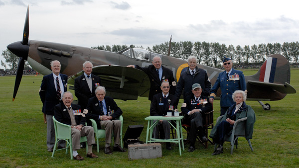 WWII Spitfire pilots seated with Spitfire